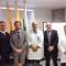 Christian González y Gabriel Bruno junto al director del hospital de Caldas, Colombia